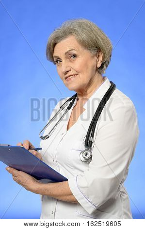 Portrait of a mature female doctor in white robe