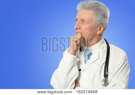 Portrait of a mature male doctor in white robe