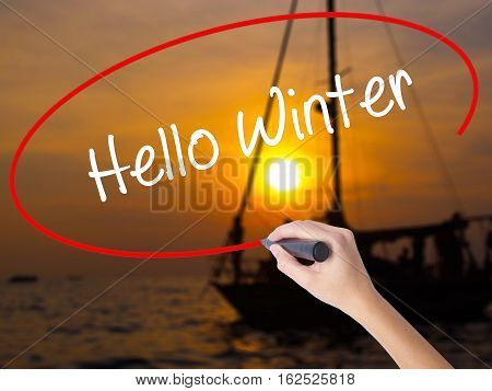 Woman Hand Writing Hello Winter With A Marker Over Transparent Board