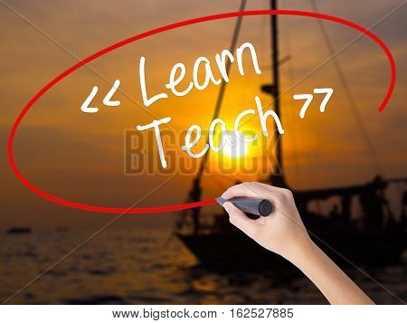 Woman Hand Writing Learn - Teach With A Marker Over Transparent Board.