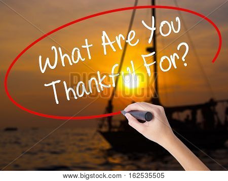 Woman Hand Writing What Are You Thankful For? With A Marker Over Transparent Board