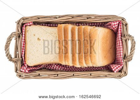 White bread in basket. Slice. Isolated on white background. Top view.