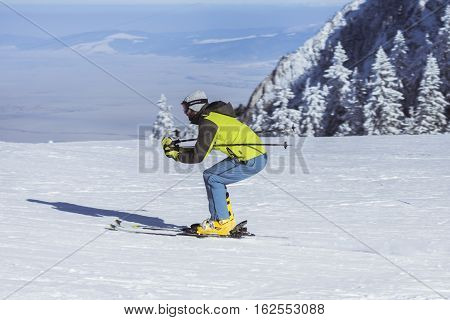 Poiana Brasov Romania - January 24 2016:Skier on the ski in the snowy winter season in the mountain resort of Poiana Brasov Romania