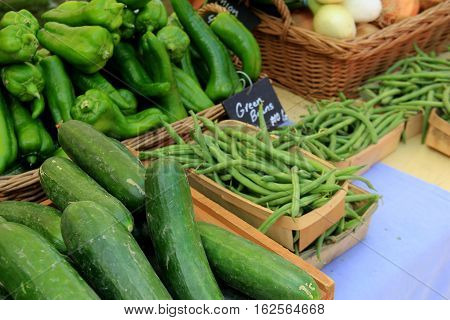 Horizontal image of fresh picked vegetables in baskets at local farmers market