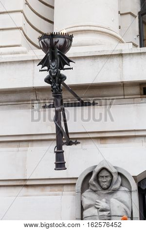 LONDON ENGLAND - DECEMBER 17: Fire torch on exterior of The London Dungeon. In London England. On 17th December 2016.