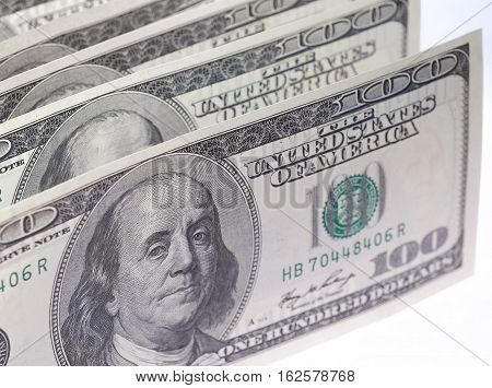 One hundred dollar bills in U.S. currency on white background.