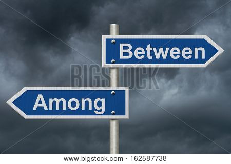 Learning to use proper grammar Blue road sign with words Between and Among with stormy sky background 3D Illustration