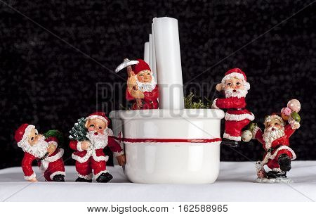 UMEA, SWEDEN ON DECEMBER 20. Happy Santa Claus figures on December 20, 2016 in Umea, Sweden. White snow, equipment and a candlestick. Illustrative editorial.