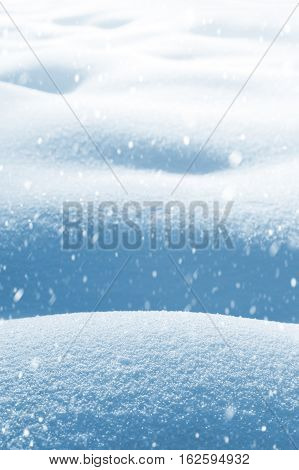 Winter background. Winter landscape with deep snow drifts and falling snow.