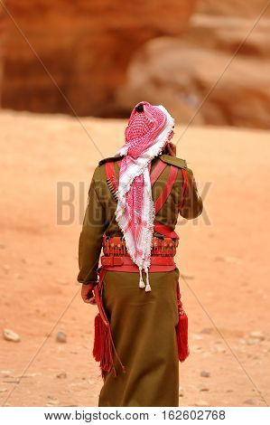 PETRA, JORDAN, MARCH 13, 2016 : A guard walking in front of The Treasury (Al Khazneh)