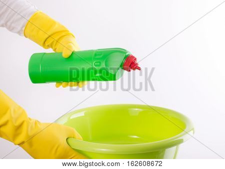 Woman Pouring Detergent Into Washbasin On White Background