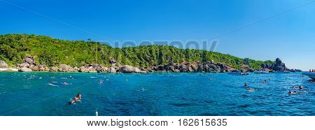Phang Nga, Thailand - January 4, 2016: View from the tour boat to the Similan Island, Andaman Sea, Thailand. Couple snorkeling and diving in crystal blue water.