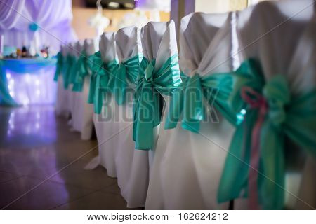 white chairs decorated for wedding wedding ceremony restaurant wedding table and chairs a feast