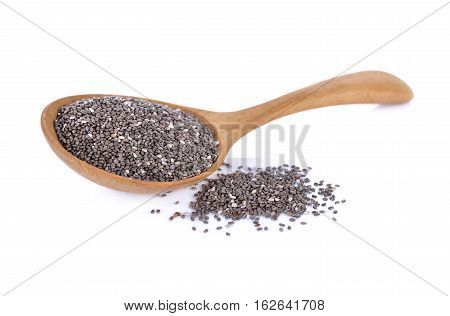 dry chia seeds in wooden spoon on white background