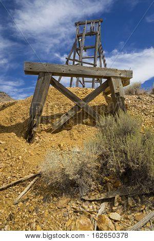 Old Mining Hoist In The Nevada Desert Under Blue Sky.