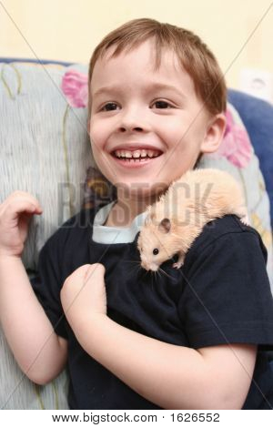 The Cheerful Boy With The Hamster On The Shoulder