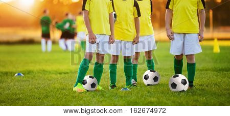 Boys Training Soccer. Children Playing Football in a Stadium. Soccer Players Team. Football Training for Kids