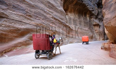 PETRA, JORDAN - MARCH 11, 2016: The Siq Canyon leading to The Treasury (Al Khazneh)