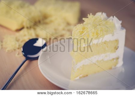 Piece Of Cake With Whip Cream And Grated Cheese Topping
