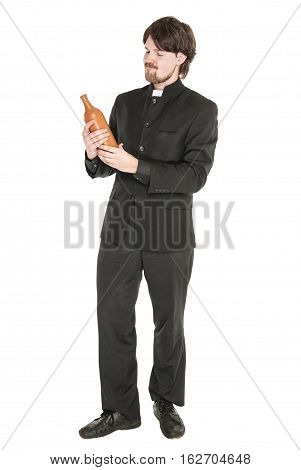 Young Priest With Bottle Of Alcohol Isolated