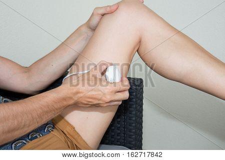 beautiful leg with epilator for epilation skin in summer
