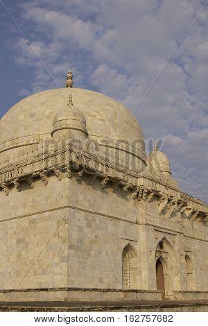 MANDU, MADHYA PRADESH, INDIA - NOVEMBER 19, 2008: Ancient islamic tomb of Hoshang Shah in the hilltop fortress of Mandu in Madya Pradesh, India. White marble building. 15th Century AD