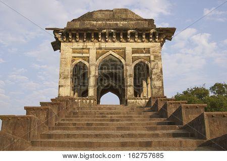 MANDU, MADHYA PRADESH, INDIA - NOVEMBER 19, 2008: Entrance to ancient islamic palace of Ashrafi Mahal in Mandu, Madhya Pradesh, India. 15th Century AD