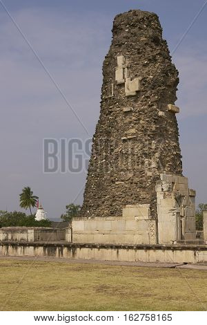 MANDU, MADHYA PRADESH, INDIA - NOVEMBER 18, 2008: Crumbling victory tower inside the ancient islamic palace of Ashrafi Mahal in Mandu, Madhya Pradesh, India. 15th Century AD