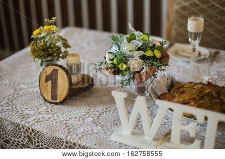 wedding table piled with food, banquet, table setting