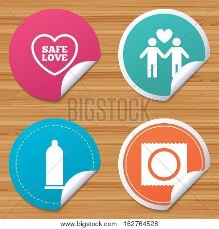 Round stickers or website banners. Condom safe sex icons. Lovers Gay couple signs. Male love male. Heart symbol. Circle badges with bended corner. Vector