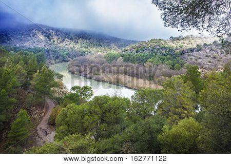One trekker man walking along the Caminito del Rey path Malaga Spain