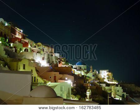 Lights Of Oia Village At Night In Santorini