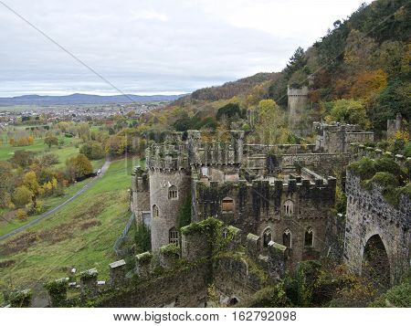 Gwrych castle - Wales - United kingdom - Autumn/ fall Surrounded with green trees and foliage. from above looking down at the castle and overlooking the town of Abergele with mountains in the distance.