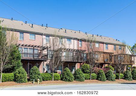 Back of Brick Townhouses under blue sky