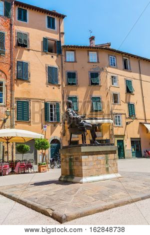 Statue Of Giacomo Puccini In Front Of His Birthplace In Lucca, Italy