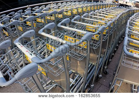 lot of trolleys for luggage at the airport.