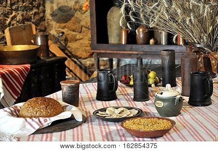 view of the dining table, bread, drink, and ripening