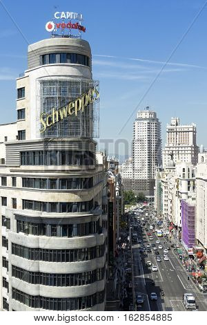 MADRID, SPAIN - AUGUST 28, 2015: Madrid citiscape, with Capitol building besides the Gran Via street, in Madrid, Spain on Aug 28, 2015