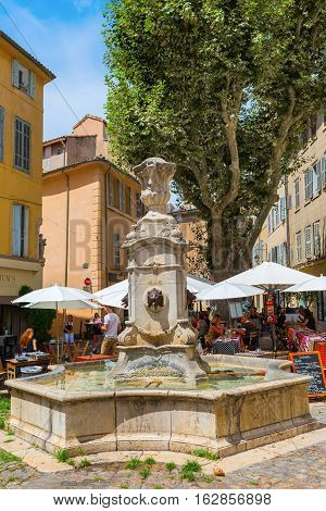 Historic Water Fountain On A Square In Aix-en-provence, France