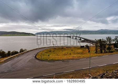 Norway Road And Bridges On Coastline Of A Fjord. Nordic Cloudy Summer Day.