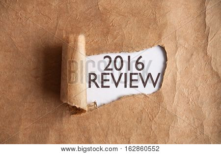 Torn piece of scroll revealing 2016 review underneath