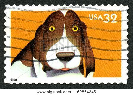 UNITED STATES OF AMERICA - CIRCA 1998: A used postage stamp from the USA portraying an illustration of a cartoon Dog circa 1998.