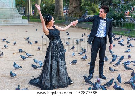 Bridal Couple At A Photo Shooting With Doves At The Notre Dame, Pairs, France