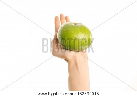 Healthy Eating And Diet Topic: Human Hand Holding A Green Sweetie Isolated On A White Background In