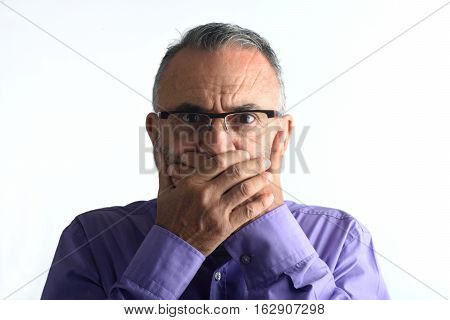 middle aged man with hand in mouth