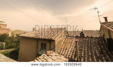 old brown roofs in Tuscany in Italy