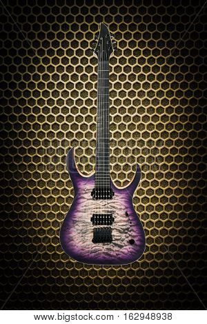 Beautiful purple wooden electric guitar on yellow abstract techno background