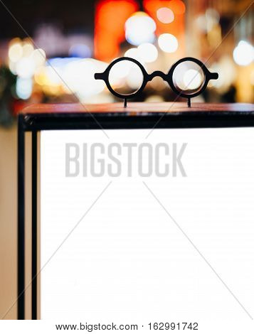 Christmas city light decorations seen through vintage eyeglasses advertising for optician shop