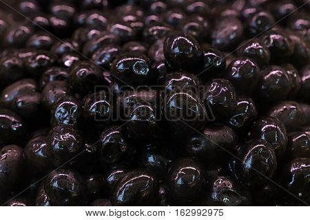 Black Whole Glossy Olives In Oil Close Up