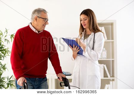 Senior Man With Walker On Consultation With Doctor